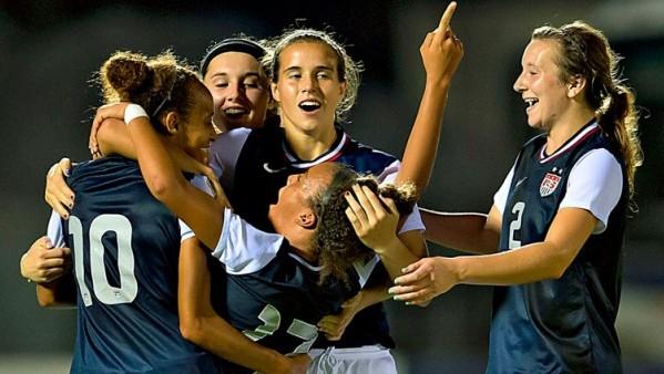 The U.S. U-17 Women celebrate during the 2013 CONCACAF U-17 women's championship. Photo property of CONCACAF.com